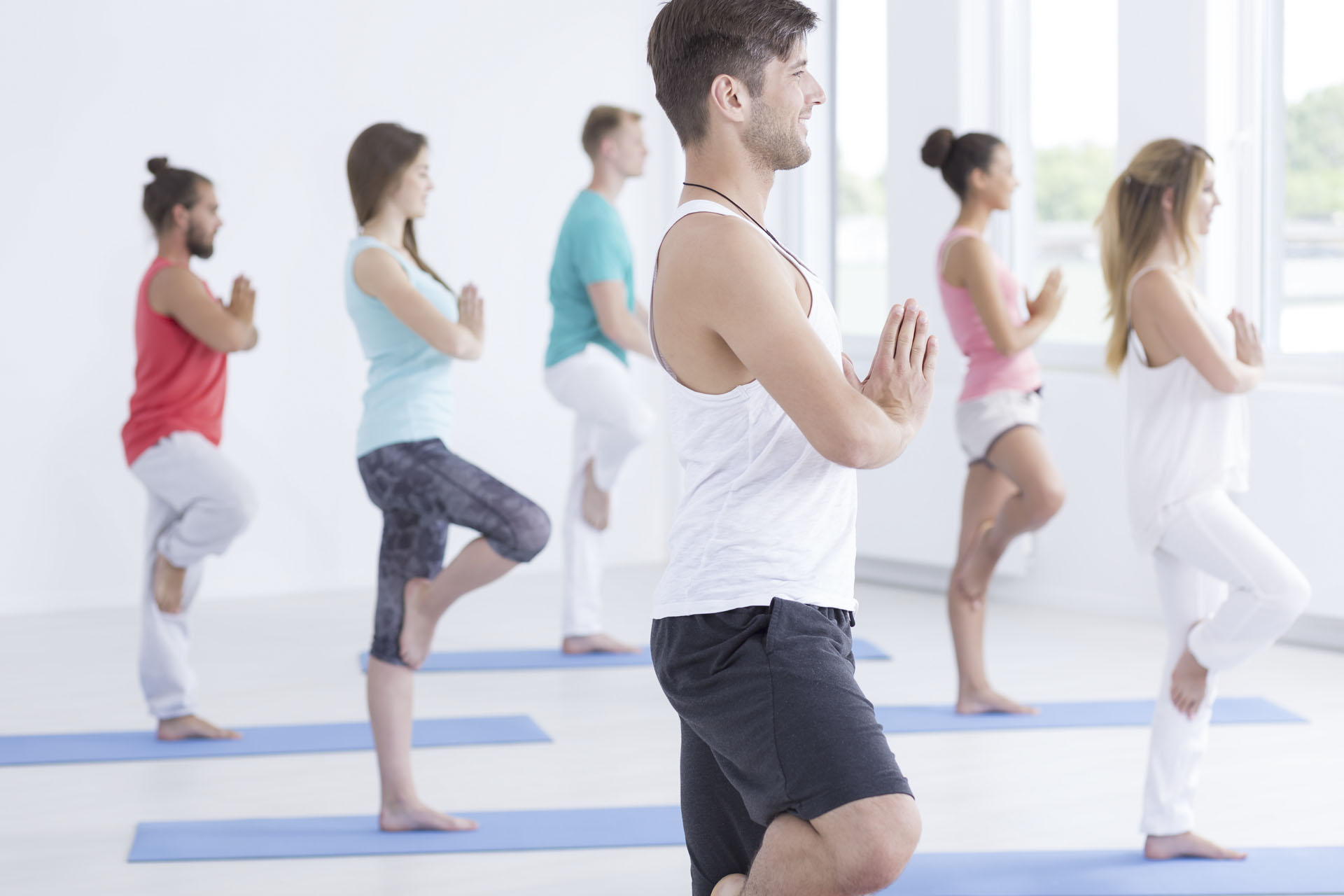 Shot of a young man doing yoga in an exercise studio