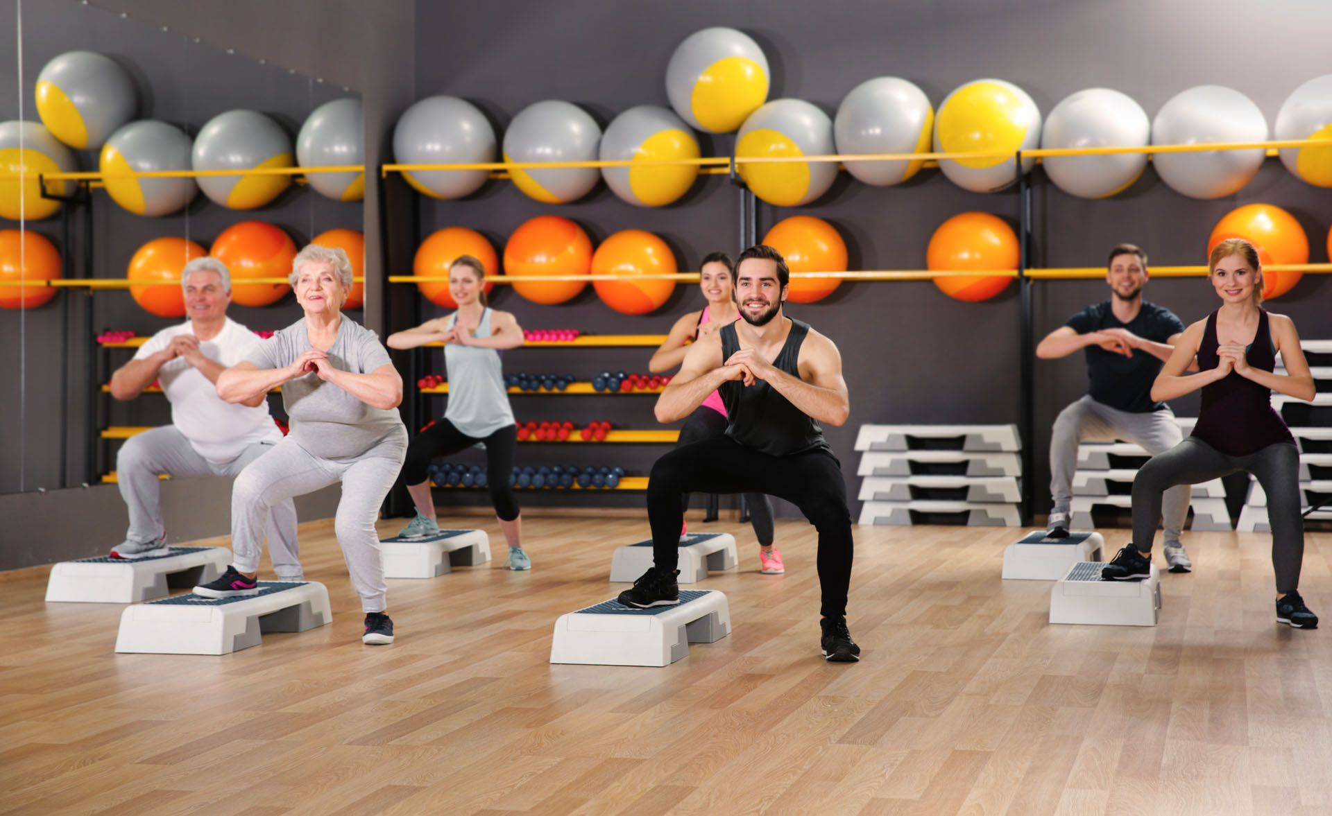 People of different ages training in gym